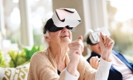 A senior at The Pillars of Shorewood Landing uses a WellnessVR headset.