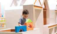 A child plays with blocks in the play area at Ridgedale Center.