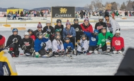 Players from the North American Pond Hockey Championship gather on the ice.