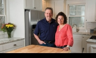 """Steve and Lynne Fisher in the newly remodeled kitchen of one of their most recent house """"flips."""""""