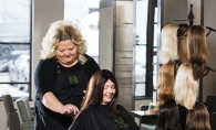 A stylist at Nedia Hair Loss Salon & Spa works on a patient's hair.