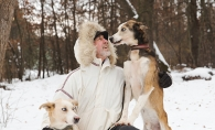 Mike Bestgen, one of the mushers in the Klondike Dog Derby, and two of his sled dogs.
