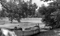 A black and white photo of a canoe set to launch on Gray's Bay on Lake Minnetonka.