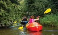 Kayakers paddle down Minnehaha Creek