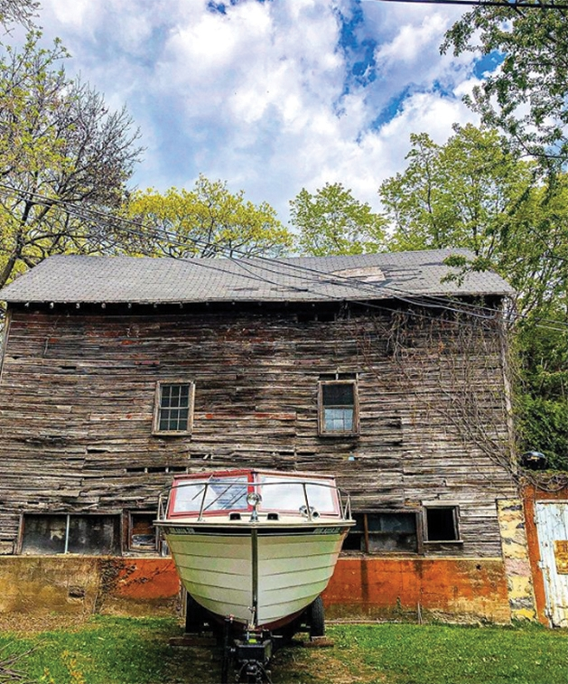 A boat sits outside a lakehouse in Excelsior, Minnesota.