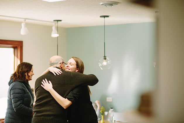 Cream & Amber founder Kacey Hruby Wyttenhove hugs Mohsen Zadeh at the shop's grand opening.