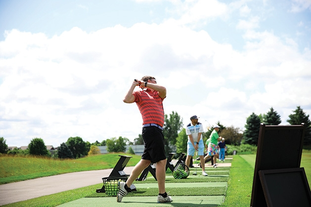 A golfer swings at the Roger Miller Golf Classic 2019