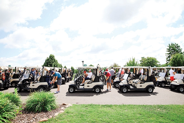 A row of golf carts at the Roger Miller Golf Classic 2019