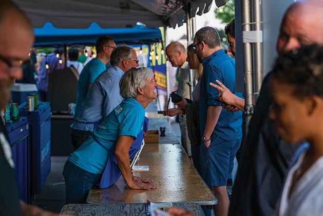 A vendor takes a man's order at James J. Hill Days 2019.