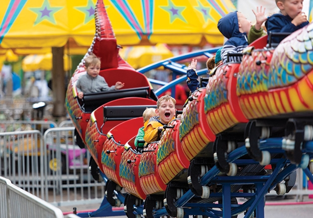 Children ride the roller coaster at James J. Hill Days 2019.