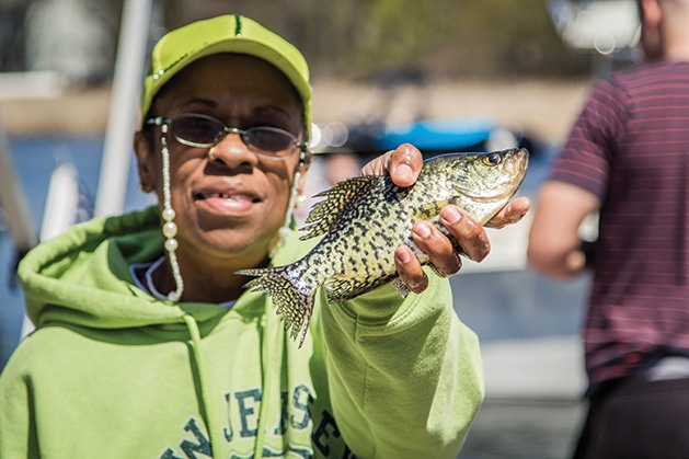 A fisherman holds their catch at the 51st Annual Minnesota Bound Crappie Contest