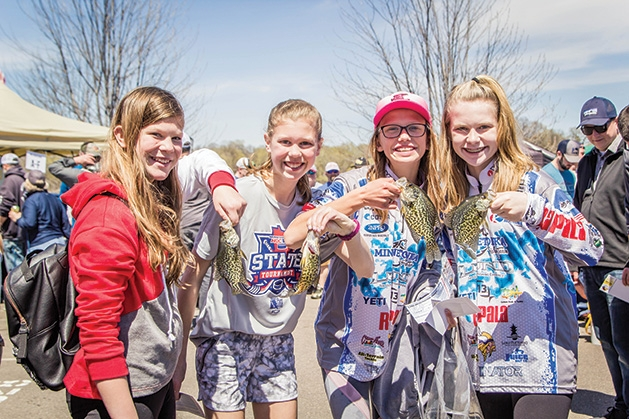 Four girls hold up their catches at the 51st Annual Minnesota Bound Crappie Contest