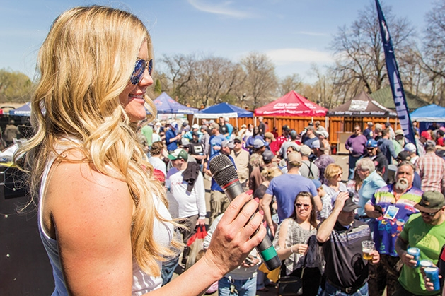 A woman makes an announcement at the 51st Annual Minnesota Bound Crappie Contest