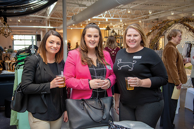 Three members of the Twin Cities Wedding & Event Professionals pose for a photo.