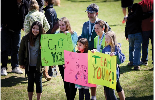 """Julie and Steve Young with their cheering team """"Team Young"""""""