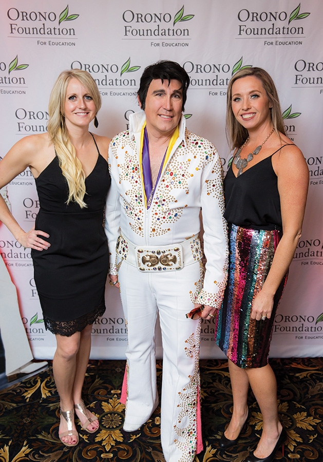 An Elvis impersonator poses with Sarah Cole and Katie Hollerman at the Orono Foundation's 2019 Red and Blue Bash