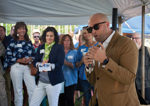 Robert Foster speaks to the crowd at Wine on Wayzata Bay.