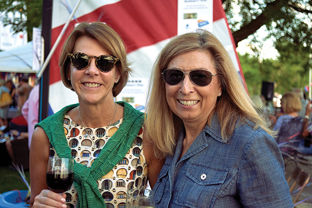 Attendees at Wine on Wayzata Bay pose for a photo.