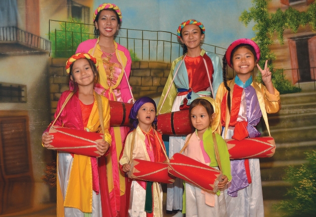 Members of the Hoang Anh dance group celebrate Vietnamese New Year.