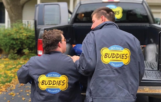Buddies Pet Food Delivery employees deliver food.