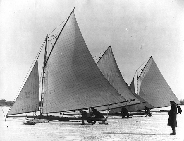 In this historical photo, a group of ice boats sail on Lake Minnetonka.