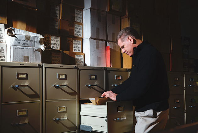 Author and Lake Minnetonka historian combs through the records at the Excelsior-Lake Minnetonka Historical Society.