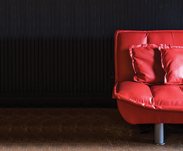 A red couch at The Freight Room, the music venue connected to The Depot Coffee House