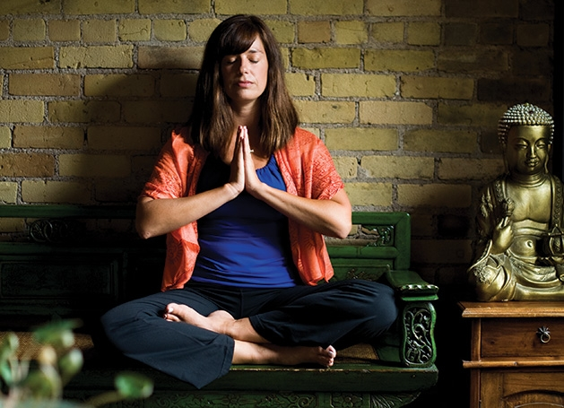 Nicole Lovald, owner of Spirit of the Lake Yoga and Wellness Center, meditates