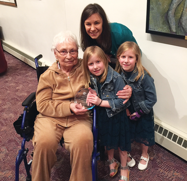 """Grandma"" Esther Begman with Candice Ledman and her daughters, with Ledman's Leo Weiss Courage to Teach Award."
