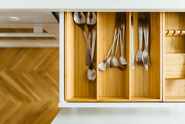 A kitchen drawer full of untensils.
