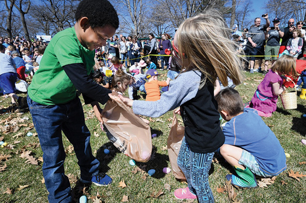 Kids with Easter baskets hunt for Easter eggs.