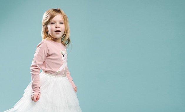 A child models clothing from Honey P's Boutique.