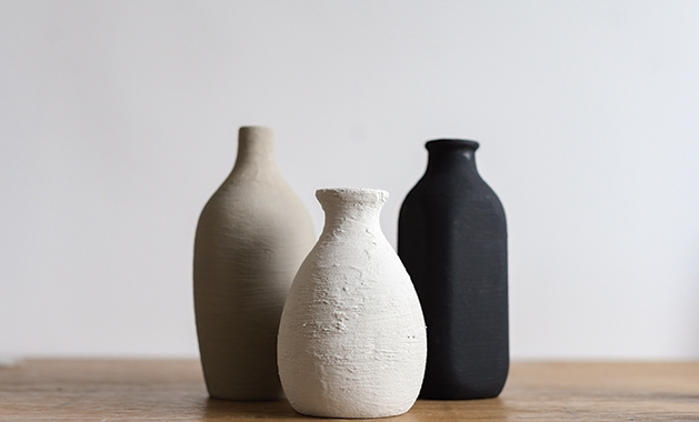 Upcycle glassware with paint and baking soda to make faux pottery.