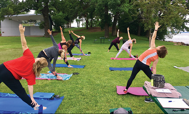 People stretch at Donation Yoga Excelsior on Lake Minnetonka.