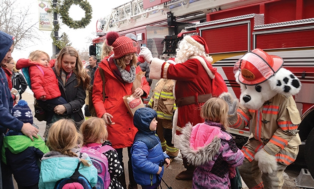 Kids meet the Excelsior Fire District mascot Sparky at a free family movie event.