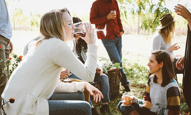 A group of friends enjoy glasses of wine while on vacation.