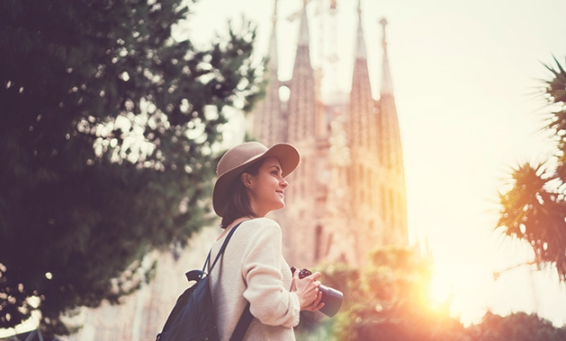 A woman takes a picture during a solo travel vacation.