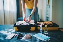 A woman packs her suitcase before a trip.