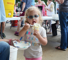 A girl enjoys an ice cream cone at the Excelsior Fire District dance.
