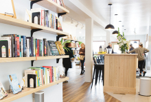 The bookshelves and community space at Cream & Amber, a Hopkins store offering books, beer, coffee and more.