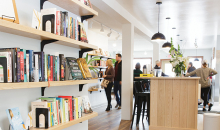 The bookshelves and bar at Cream & Amber, a new bookstore/taproom/coffee shop in Hopkins.