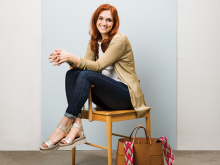 Personal stylist Jess Burke sits on a chair.