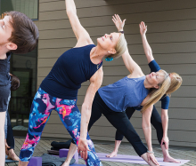 A yoga class stretches at The Marsh, Lake Minnetonka's Best Fitness Studio/Yoga Studio/Gym