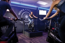 A cycling class at Moxx Cycling in Long Lake.