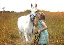 A girl and a white horse