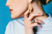 A model shows off earrings and rings from Patrick Mohs Jewelry