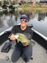 Pro angler Nicole Jacobs holds a fish