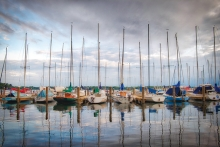 Sailboats float in the harbor at Wayzata Bay as a storm approaches Lake Minnetonka.