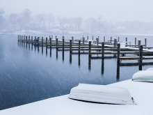 The aftermath of a spring blizzard on a dock on Lake Minnetonka.