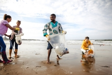 Volunteers clean up a beach